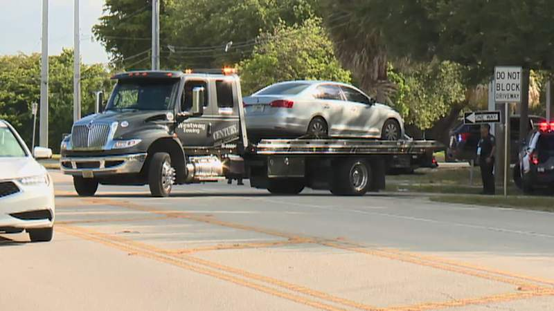 A suspect's vehicle is towed away after a shooting that occurred near a preschool in Boca Raton.