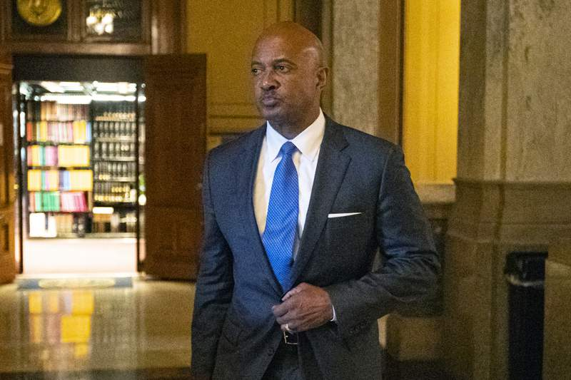 """FILE - In this Oct. 23, 2019, file photo, Indiana Attorney General Curtis Hill arrives for a hearing at the state Supreme Court at the Statehouse in Indianapolis. Hill's law license will be suspended for 30 days over an allegation that he drunkenly groped four women during a party, the state Supreme Court ruled Monday, May 11, 2020. The unanimous court decision said that the state's attorney disciplinary commission """"proved by clear and convincing evidence that (Hill) committed the criminal act of battery."""" (AP Photo/Michael Conroy, File)"""