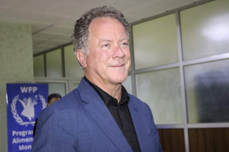 FILE - World Food Program (WFP) Executive Director David Beasley speaks to the media about the organization's Nobel Peace Prize win, at the airport in Ouagadougou, Burkina Faso, late Friday, Oct. 9, 2020.  Beasley says the Nobel Peace Prize has given the U.N. agency a spotlight and megaphone to warn world leaders that next year is going to be worse than this year, and without billions of dollars we are going to have famines of biblical proportions in 2021.   (AP Photo/Sam Mednick)