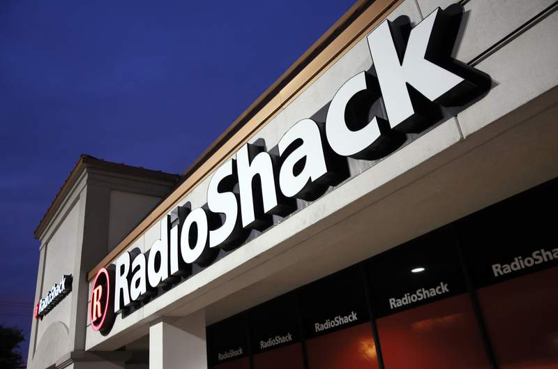 FILE - This Tuesday, Feb. 3, 2015 file photo shows a RadioShack store in Dallas.  RadioShack, the nearly century-old electronics retailer ubiquitous in malls for decades, has been pulled from brink of death  again. Its the most prized name in the basket of retail brands that entrepreneur investors Alex Mehr and Tai Lopez have scooped up for a relative pittance since the coronavirus pandemic landed on U.S. shores.   (AP Photo/Tony Gutierrez, File)