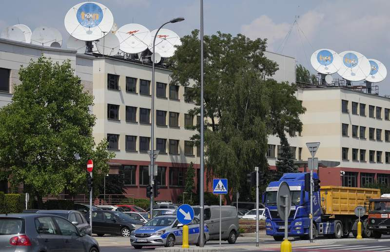 FILE - This Thursday, July 8, 2021 file photo shows the Warsaw headquarters of Poland's TVN broadcaster that is owned by the U.S. company Discovery Inc., in Warsaw, Poland. The U.S. company Discovery Inc. said Monday Aug. 16, 2021, it has been granted a Dutch license that would allow it to keep broadcasting its independent news channel TVN24 into Poland. The announcement comes as Poland's state broadcasting authority has for a year and a half refused to renew TVN24's license, which expires Sept. 26. (AP Photo/Czarek Sokolowski, File)