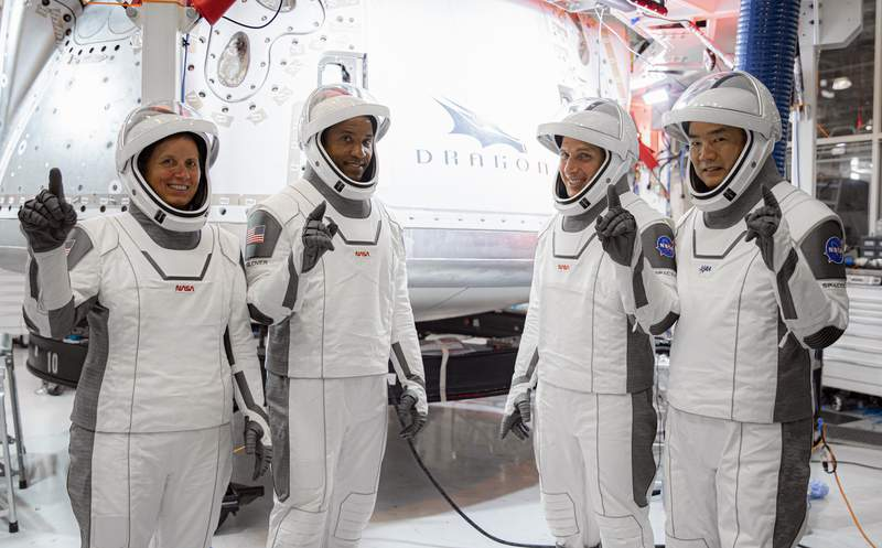 In this Thursday, Sept. 24, 2020, image released by SpaceX/NASA, NASAs SpaceX Crew-1 astronauts, from left, mission specialist Shannon Walker, pilot Victor Glover, and Crew Dragon commander Michael Hopkins, all NASA astronauts, and mission specialist Soichi Noguchi, Japan Aerospace Exploration Agency (JAXA) astronaut, gesture during crew equipment interface testing at SpaceX headquarters in Hawthorne, Calif. SpaceXs second astronaut flight is off until mid-November 2020 because red lacquer dripped into tiny vent holes in two rocket engines that now must be replaced. (SpaceX/NASA via AP)