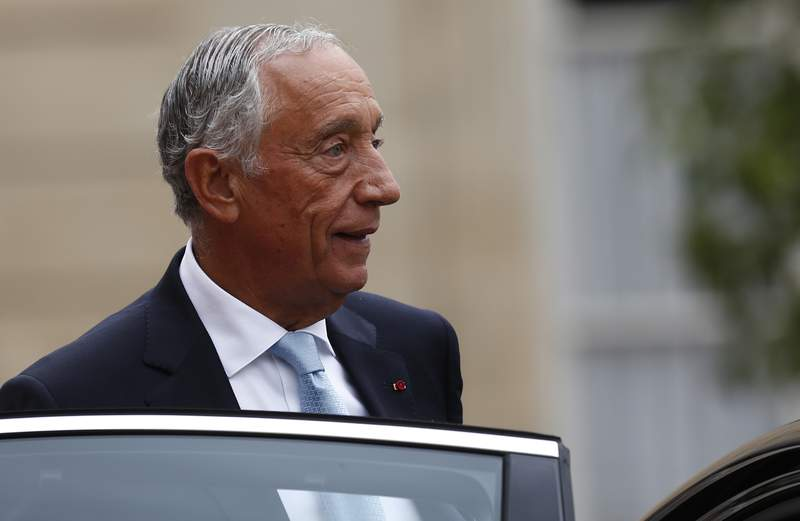 FILE - In this Sunday, July 14, 2019 file photo, Portugal's President Marcelo Rebelo de Sousa leaves after a lunch at the Elysee Palace that followed Bastille Day parade on the Champs-Elysees avenue in Paris. The office of Portugal's 71-year-old president said Sunday March 8, 2020 that he has canceled all public activities and will stay at home amid the coronavirus outbreak. (AP Photo/Kamil Zihnioglu, File)