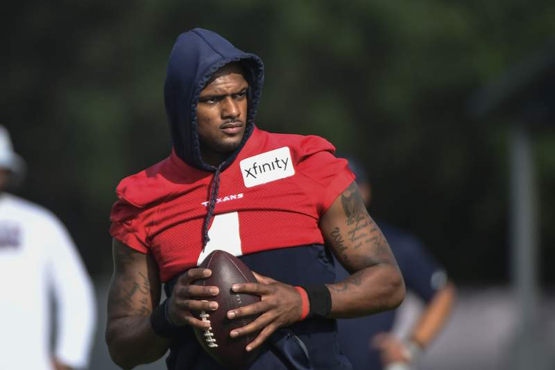 FILE- In an Aug. 2, 2021 file photo, Texans quarterback Deshaun Watson practices with the team during NFL football practice in Houston. Attorneys involved in the lawsuits accusing Watson of sexual assault and harassment say the FBI has become involved in the case. Tony Buzbee, the attorney for the 22 women who have sued Watson, said Wednesday, Aug. 18, 2021 he and some of his clients have spoken with FBI agents about the allegations against Watson.(AP Photo/Justin Rex_file)