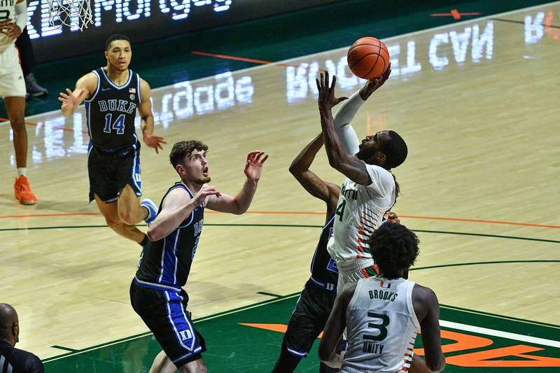 Elijah Olaniyi of the Miami Hurricanes shoots the ball against the Duke Blue Devils during the second half at Watsco Center on February 01, 2021 in Miami, Florida.