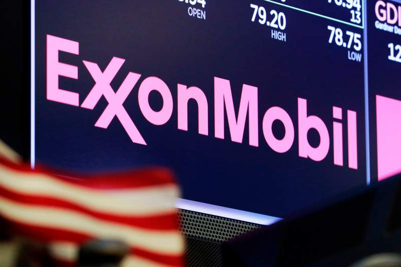 FILE - In this April 23, 2018, file photo, the logo for ExxonMobil appears above a trading post on the floor of the New York Stock Exchange. Exxon Mobil shareholders have unseated a third board member in their bid to force the oil giant to deal more aggressively with climate change. The company announced Wednesday, June 2, 2021 that three candidates nominated by a dissident group of shareholders, called Engine No. 1, had been elected to its board of directors. Preliminary tallies had two of the challengers winning seats. (AP Photo/Richard Drew, File)