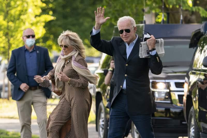 President Joe Biden with first lady Jill Biden waves as they walk on the Ellipse near the White House in Washington to board the Marine One, Saturday, May 15, 2021. (AP Photo/Manuel Balce Ceneta)