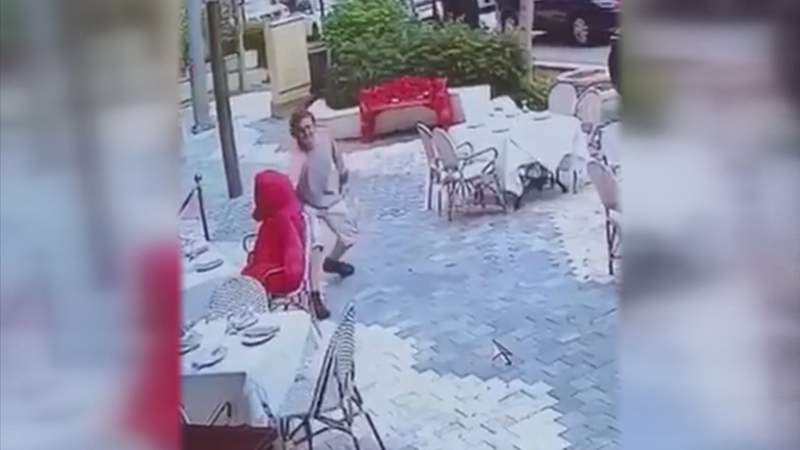 Surveillance video captures an individual stealing a giant teddy bear from outside the Gramercy restaurant in Coral Gables.