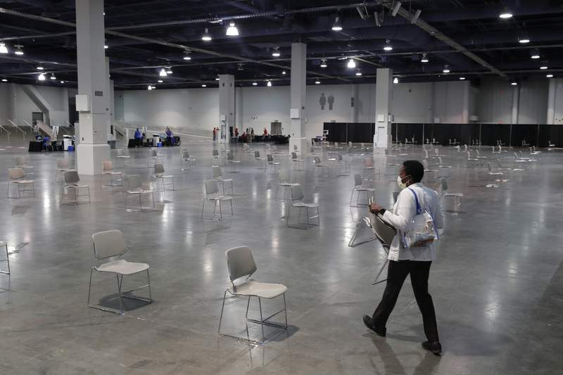 Chairs are spaced out for social distancing at a temporary coronavirus testing facility for casino employees at the Las Vegas Convention Center, Thursday, May 21, 2020, in Las Vegas. (AP Photo/John Locher)