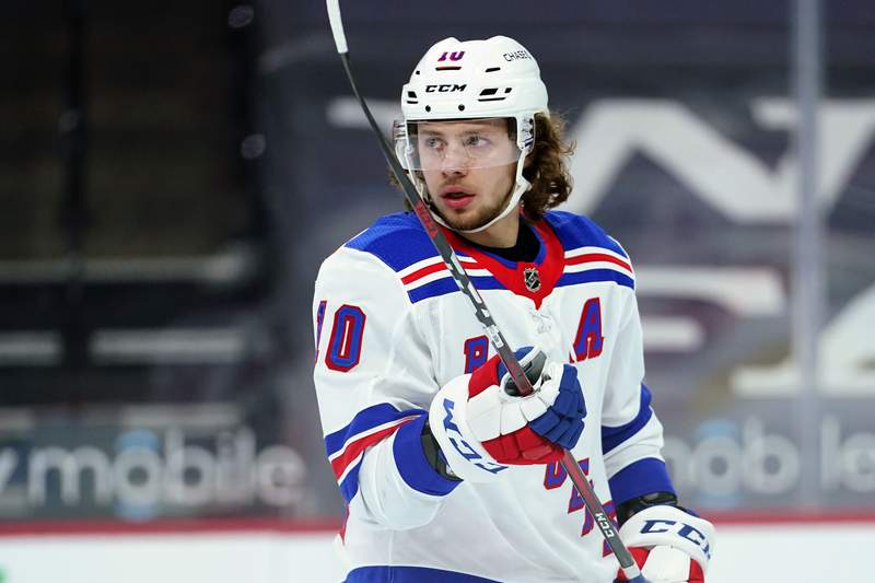 FILE - In this Feb. 18, 2021, file photo, New York Rangers' Artemi Panarin plays during an NHL hockey game against the Philadelphia Flyers in Philadelphia. Panarin has rejoined the Rangers after taking a two-week leave of absence. He was on the ice with teammates at practice Wednesday, March 10, 2021, in Boston, though Rangers coach David Quinn said he wont play Thursday against the Bruins and has no timeline for his return to game action. (AP Photo/Matt Slocum, File)