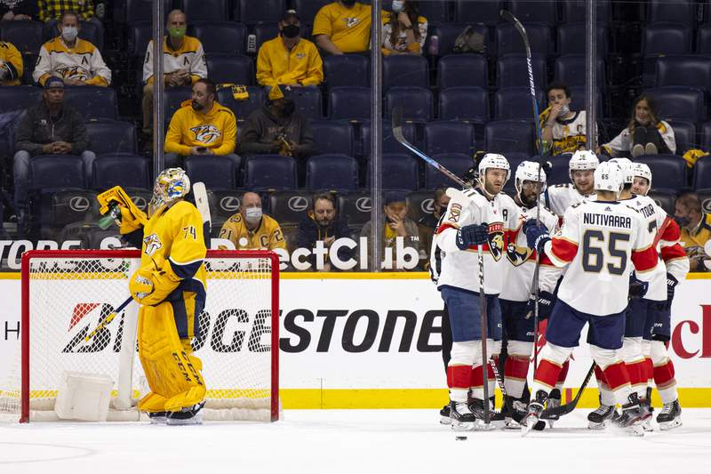 Sam Bennett of the Florida Panthers celebrates with teammates after his goal against the Nashville Predators during the first period at Bridgestone Arena on April 26, 2021 in Nashville, Tennessee.