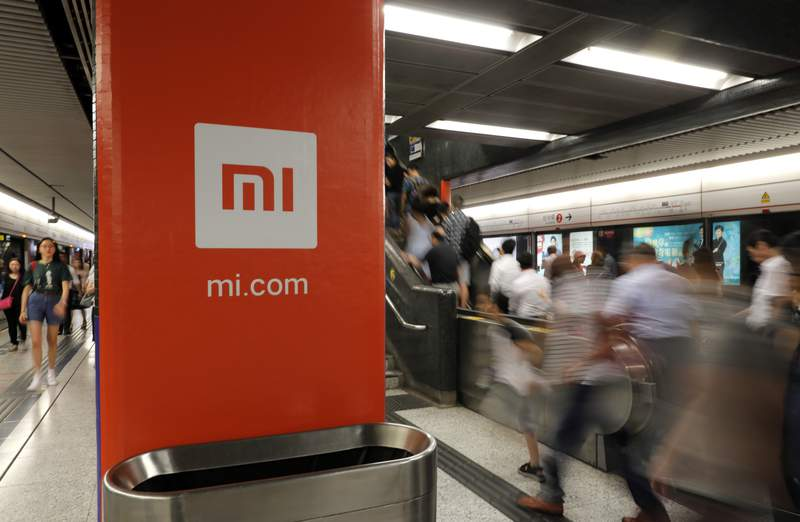 FILE - In this July 9, 2018, file photo, an advertisement for Xiaomi is displayed at a subway station in Hong Kong. The U.S. government has blacklisted Chinese smartphone maker Xiaomi Corp. and Chinas third-largest national oil company for alleged military links, heaping pressure on Beijing in President Donald Trumps last week in office. The Department of Defense added nine companies to its list of Chinese companies with military links, including Xiaomi and state-owned plane manufacturer Commercial Aircraft Corp. of China (Comac). (AP Photo/Vincent Yu, File)