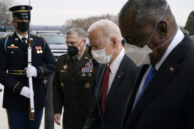 FILE - In this Feb. 10, 2021, file photo, President Joe Biden walks with Joint Chiefs Chairman Gen. Mark Milley, second from left, and Defense Secretary Lloyd Austin as he arrives at the Pentagon in Washington. Milley says he is now open to considering a proposal to take decisions on sexual assault prosecution out of the hands of military commanders. This is a potentially significant shift in the debate over combating sexual assault in the military.(AP Photo/Patrick Semansky, File)