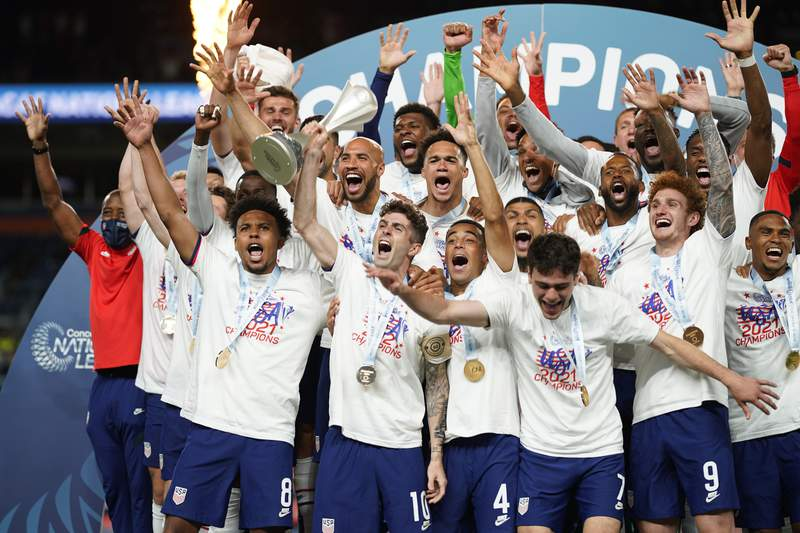 Members of the United States celebrate a 3-2 win against Mexico in extra time in the CONCACAF Nations League championship soccer match, Sunday, June 6, 2021, in Denver. (AP Photo/Jack Dempsey)