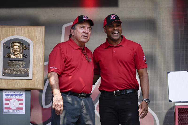 Former Cincinnati Reds player Johnny Bench, left, and Barry Larkin participate in Joe Morgan Day at a baseball game between the Pittsburgh Pirates and the Reds at Great American Ballpark in Cincinnati on Sunday, Aug. 8, 2021. (AP Photo/Jeff Dean)
