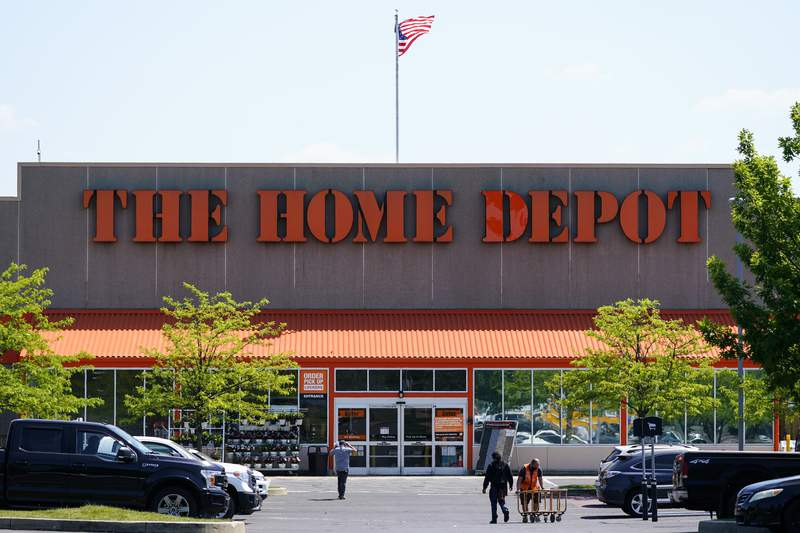 This May 19, 2021 photo shows The Home Depot location in Willow Grove, Pa. Home Depots sales continued to rise in its fiscal second quarter, thanks to a housing market that remains hot.  Chairman and CEO Craig Menea said in a statement on Tuesday, Aug. 17,  that this was the first time in its history that the chain surpassed sales of more than $40 billion in a quarter. (AP Photo/Matt Rourke)