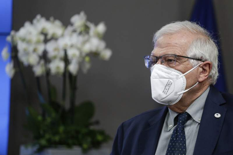 European Union foreign policy chief Josep Borrell leaves at the end of the first day of an EU summit at the European Council building in Brussels, early Friday, June 25, 2021. At their summit in Brussels, EU leaders are set to take stock of coronavirus recovery plans, study ways to improve relations with Russia and Turkey, and insist on the need to develop migration partners with the countries of northern Africa, but a heated exchange over a new LGBT bill in Hungary is also likely. (Aris Oikonomou, Pool Photo via AP)