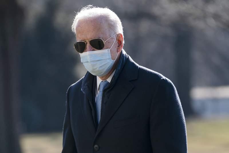 President Joe Biden arrives on the South Lawn of the White House, Monday, Feb. 8, 2021, in Washington. (AP Photo/Evan Vucci)