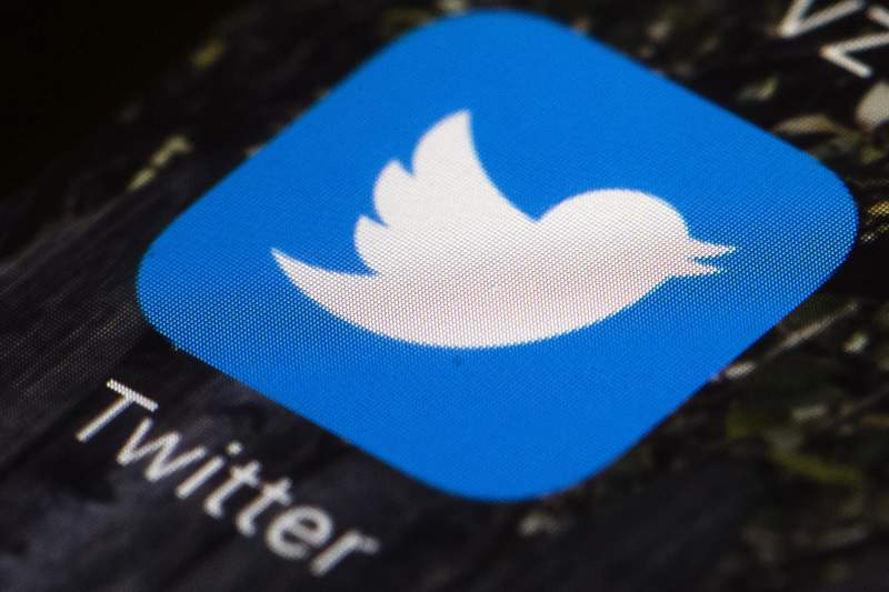FILE - This April 26, 2017, file photo shows the Twitter app icon on a mobile phone in Philadelphia. Former Ku Klux Klan leader David Duke has been banned from Twitter for breaking the social media platform's sites rules forbidding hate speech. The company said Friday, July 31, 2020 that Duke's account has been permanently suspended for repeated violations of the Twitter Rules on hateful conduct. (AP Photo/Matt Rourke, File)