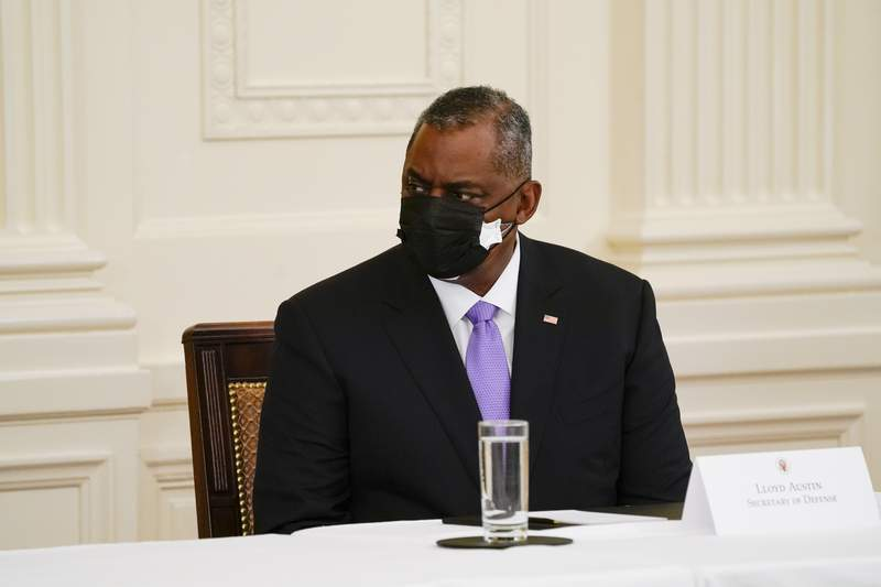 Secretary of Defense Lloyd Austin attends a Cabinet meeting with President Joe Biden in the East Room of the White House, Thursday, April 1, 2021, in Washington. (AP Photo/Evan Vucci)