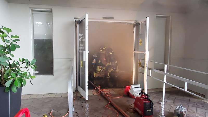 Heavy smoke fills the entryway of a Leon Medical Center in Miami.