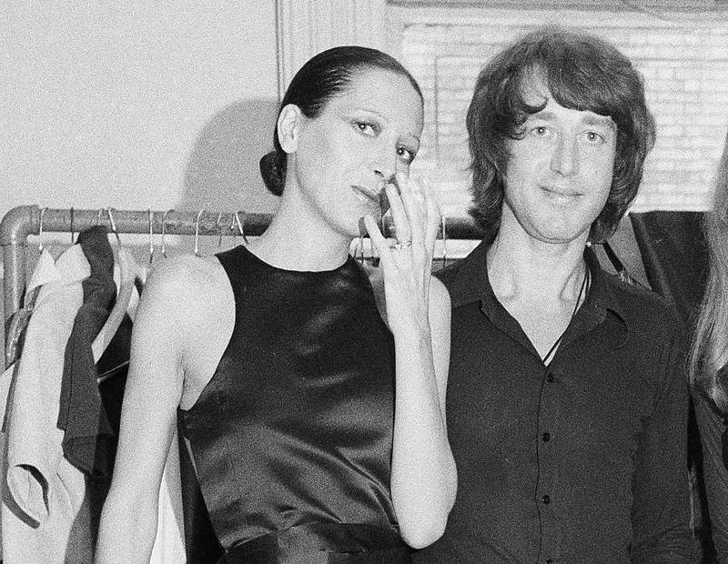 FILE - Elsa Peretti, left, poses with designer Halston after a fashion show in New York on June 15, 1970.  Famed jewelry designer Elsa Peretti, a formal Halston model turned Tiffany & Co. legend, is dead at age 80. According to a family statement, Peretti died Thursday night in her sleep at home in a small village outside Barcelona.  (AP Photo/Marty Lederhandler, File)