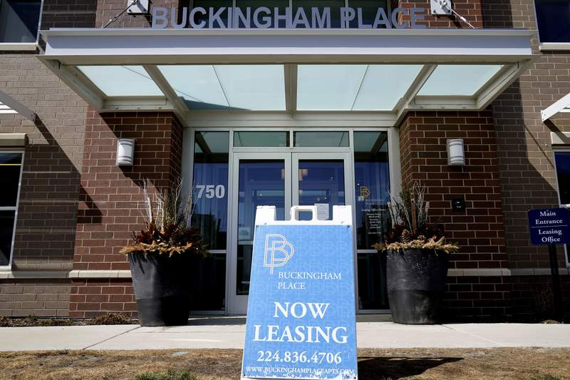 This March 21, 2021 photo shows a leasing sing is displayed outside of residential building in Des Plaines, Ill. Things are looking up for owners of big apartment communities more than a year after the pandemic knocked the economy into a recession and left millions of Americans unemployed. Rents are rising amid strong demand as U.S. home prices push ever higher.   (AP Photo/Nam Y. Huh)