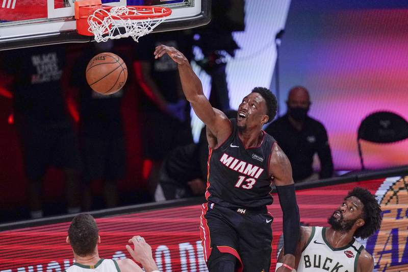 Miami Heat's Bam Adebayo dunks during the second half of an NBA conference semifinal playoff basketball game against the Milwaukee Bucks Sunday, Sept. 6, 2020, in Lake Buena Vista, Fla. (AP Photo/Mark J. Terrill)