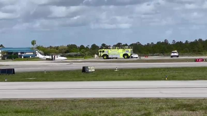 Plane lands with gear retracted at Fort Lauderdale Executive Airport.