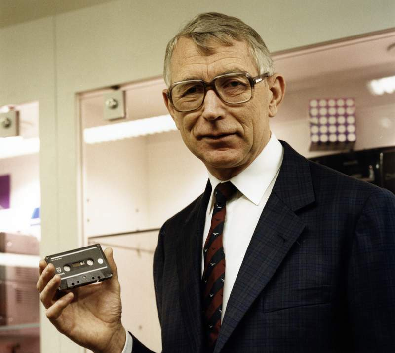 In this photo dated 1988, structural engineer Lou Ottens holding an audio cassette poses for a photo.  The Dutch inventor of the cassette tape, Ottens died Saturday March 6, 2021, at the age of 94, according to an announcement issued by the Philips company. (Philips Company Archives via AP)