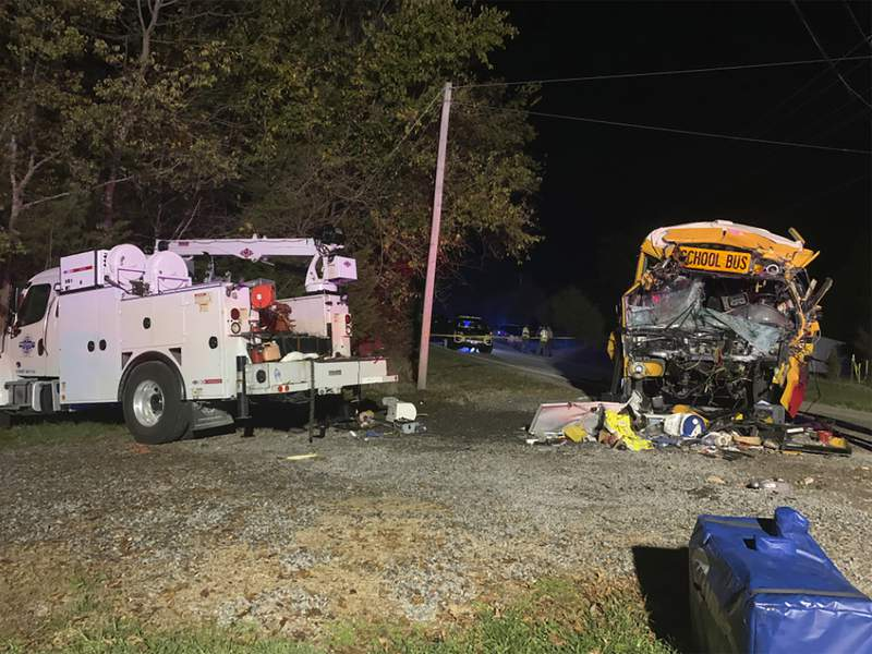 This photo provided by the Tennessee Highway Patrol shows the scene of deadly crash involving a utility vehicle and a school bus carrying children on Tuesday evening, Oct. 27, 2020, in Decatur, Tenn. (Tennessee Highway Patrol via AP)