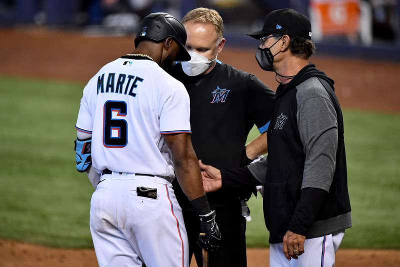 Don Mattingly pulls Starling Marte of the Miami Marlins from the game due to injury in the ninth inning against the San Francisco Giants at loanDepot park on April 18, 2021 in Miami, Florida. (Photo by Mark Brown/Getty Images)
