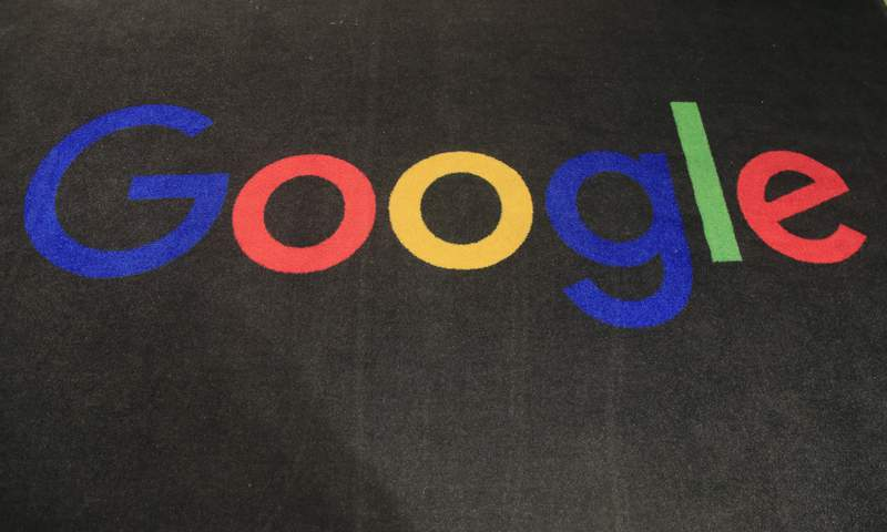 FILE - In this Monday, Nov. 18, 2019, file photo, the logo of Google is displayed on a carpet at the entrance hall of Google France in Paris. South Koreas competition watchdog says it plans to fine Google at least 207.4 billion won ($177 million) for allegedly blocking smartphone makers like Samsung from using other operating systems, in what would be one of the country's biggest antitrust penalties ever. (AP Photo/Michel Euler, File)