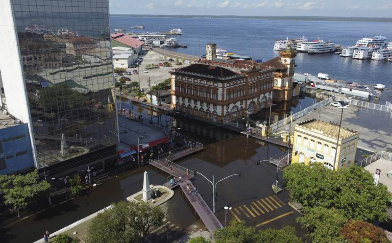 Aerial view of streets flooded by the Negro River, in downtown Manaus, Amazonas state, Brazil, Tuesday, June 1, 2021. Rivers around Brazil's biggest city in the Amazon rain forest have swelled to levels unseen in over a century of record-keeping, according to data published Tuesday by Manaus' port authorities. (AP Photos/Nelson Antoine)