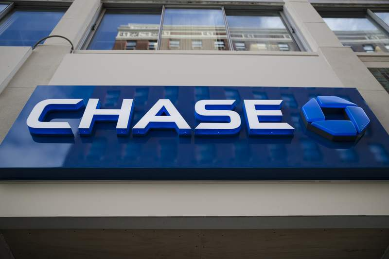 FILE - This Nov. 29, 2018 file photo shows a Chase bank location in Philadelphia. JPMorgan Chase will take another crack at fixing health care after a push with two other corporate giants dissolved earlier this year. The bank said Thursday, May 20, 2021, that it formed a new business focused on improving care provided for about 285,000 people through its employer-sponsored health plan. (AP Photo/Matt Rourke, File)