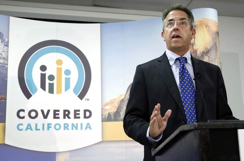FILE - In this Nov. 13, 2013, file photo, Peter Lee, executive director of Covered California, the state's health insurance exchange, speaks at a news conference in Sacramento, Calif. On Thursday, Sept. 16, 2021, Lee announced that he will step down from his position in February of 2022. Lee has been Covered California's only executive director since it was launched in 2012. (AP Photo/Rich Pedroncelli, File)