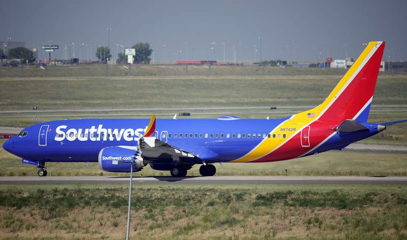 FILE - In this July 2, 2021, file photo, a Southwest Airlines jetliner taxis down a runway for take off from Denver International Airport in Denver. Southwest Airlines canceled hundreds more flights Monday, Oct. 11, 2021 following a weekend of major service disruptions. By midmorning Monday, Southwest had canceled about 360 flights and more than 600 others were delayed. (AP Photo/David Zalubowski, File)
