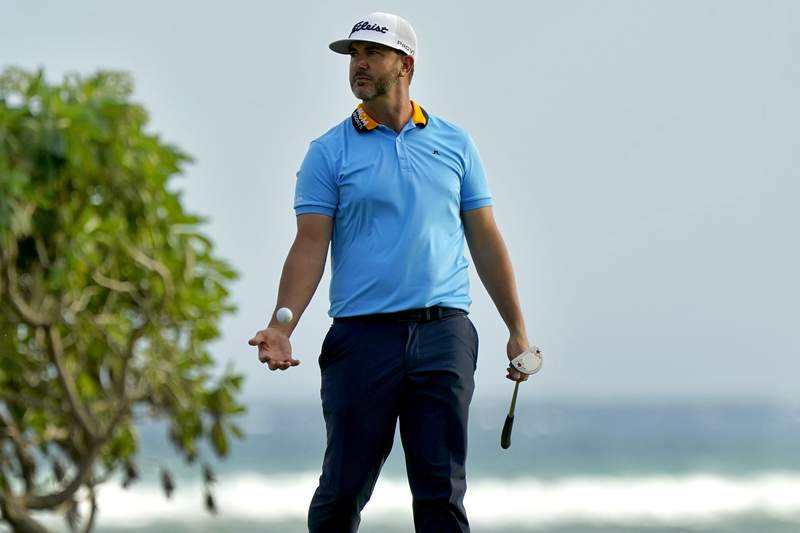 Scott Piercy tosses his ball after missing his birdie putt on the 16th green during the first round of the Sony Open PGA Tour golf event, Thursday, Jan. 9, 2020, at Waialae Country Club in Honolulu. (AP Photo/Matt York)