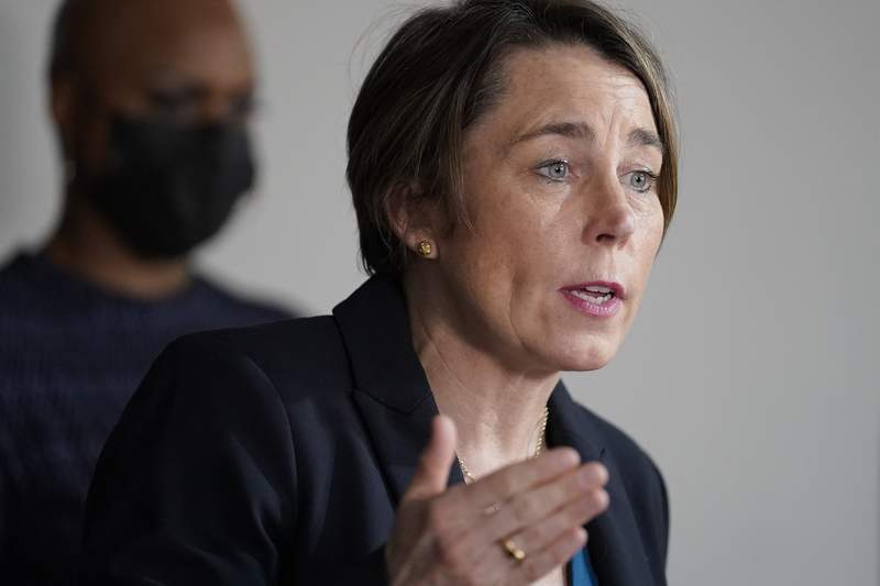 FILE - In this April 1, 2021 file photo, Mass. Attorney General Maura Healey, right, responds to questions from reporters as U.S. Rep. Ayanna Pressley, D-Mass., left, looks on during a news conference in Boston. Healey says Purdue Pharma's plan to settle thousands of lawsuits over the U.S. opioid epidemic doesnt go far enough to hold members of the Sackler family accountable for the crisis. It would preserve the vast majority of the wealth held by the family members who own the company that makes OxyContin.  (AP Photo/Steven Senne)