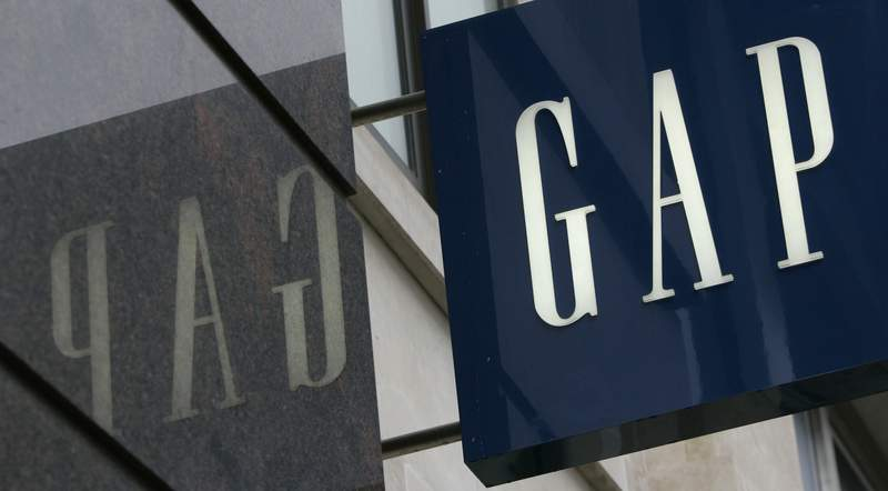 FILE - In this Wednesday, Aug. 13, 2018 file photo, a sign for the Gap store seen in London's Oxford Street.  American clothing retailer Gap announced that it will close all of its 81 stores in the U.K. and Ireland by the end of 2021. It will shift its business to exclusively online. The announcement late Wednesday,  June 30, 2021, comes following a strategic review that sought more cost-effective solutions for its presence in Europe. (AP Photo/Alastair Grant, File)