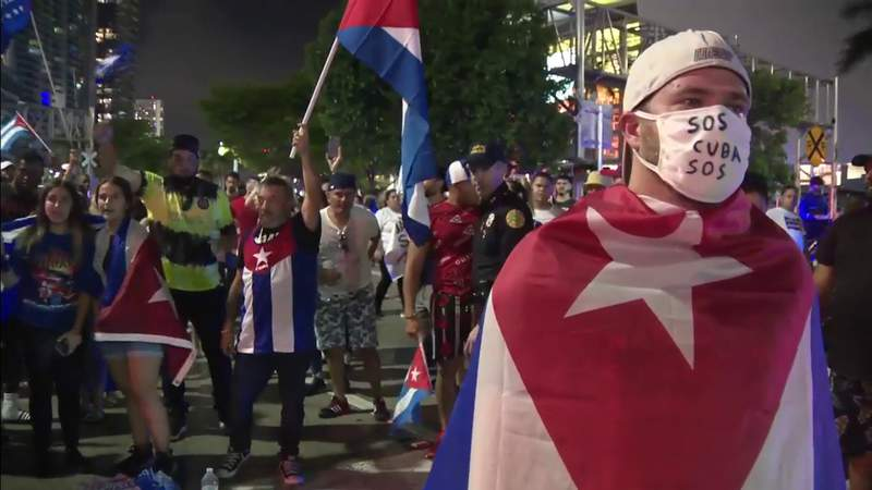 Miami SOS Cuba protesters march from Versailles to Freedom Tower