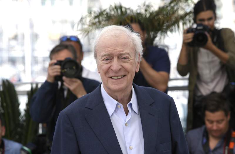 FILE - In this Wednesday, May 20, 2015 file photo, Michael Caine poses for photographers during a photo call for the film Youth, at the 68th international film festival, Cannes, southern France. The international film festival returns to the Czech spa of Karlovy Vary after two years due to a delay caused by the coronavirus pandemic. The 55th edition of the fest will honor English Oscar-winning English actor Michael Caine for his outstanding contribution to world cinema at its start on Friday, Aug, 20, 2021.(AP Photo/Lionel Cironneau, file)