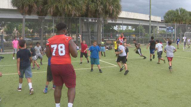 The Hurricanes played football with kids at the Boys & Girls Club
