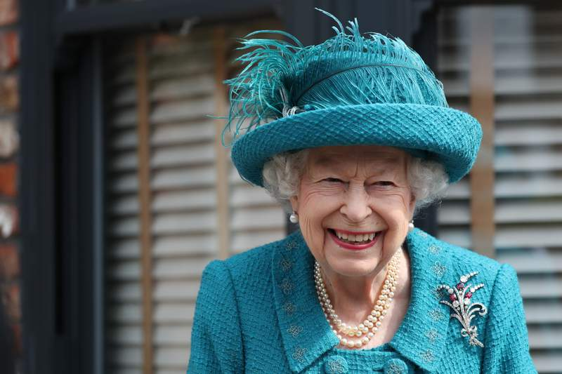 FILE - In this Thursday July 8, 2021 file photo, Britain's Queen Elizabeth visits the set of the long running television series Coronation Street, in Manchester, England.  Queen Elizabeth II and the Royal Family back the Black Lives Matter movement, one of her senior representatives has said in a television interview to be broadcast later Friday, Sept. 10. (AP Photo/Scott Heppell, file)