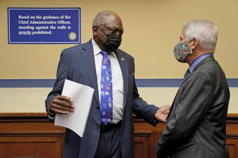 Dr. Anthony Fauci, director of the National Institute of Allergy and Infectious Diseases, speaks with Rep. Jim Clyburn, D-S.C., before a House Select Subcommittee on the Coronavirus Crisis on the Capitol Hill in Washington, Thursday, April 15, 2021. (Amr Alfiky/The New York Times via AP, Pool)