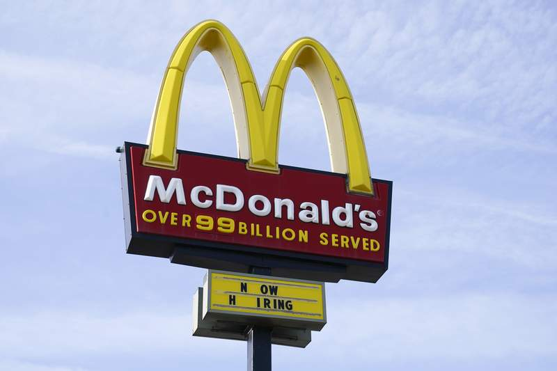 A sign is displayed outside a McDonald's restaurant, Tuesday, April 27, 2021, in Des Moines, Iowa.  McDonalds is the latest company to be hit by a data breach, saying there was unauthorized activity on its network that exposed the personal data of some customers in South Korea and Taiwan. McDonalds Corp. said in a statement Friday, June 11,  that it quickly identified and contained the incident and that a thorough investigation was done.  (AP Photo/Charlie Neibergall)
