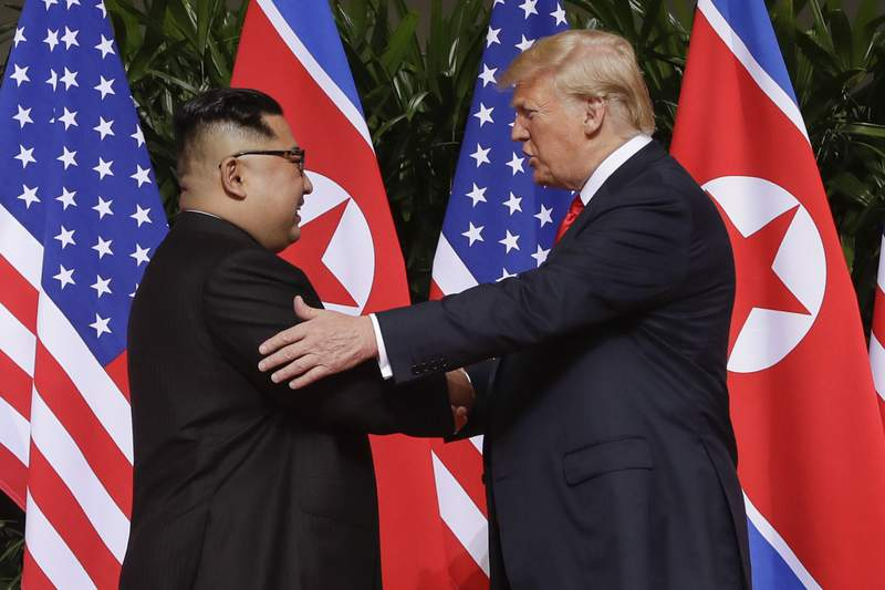 FILE - In this June 12, 2018, file photo, President Donald Trump, right, shakes hands with North Korea leader Kim Jong Un at the Capella resort on Sentosa Island in Singapore. North Korea on Tuesday, July 7, 2020, repeated it has no immediate intent to resume dialogue with the United States hours before U.S. Deputy Secretary of State Stephen Biegun was to arrive in South Korea for discussions on the stalled nuclear diplomacy. (AP Photo/Evan Vucci, File)