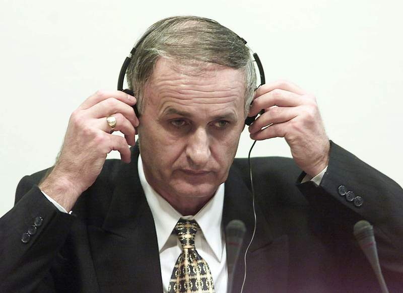 In this Thursday, Aug. 2, 2001 file photo, Bosnian Serb Gen. Radislav Krstic puts on headphones as he takes his seat in the courtroom in The Hague, Netherlands. Authorities in Bosnia on Wednesday, Sept. 16, 2020 arrested seven Bosnian Serb former military officers and troops suspected in the killing of 44 Bosniak civilians during the 1992-95 war. Among the suspects is Gen. Radislav Krstic, who is serving a 35-year-old prison sentence. In 2004, he was convicted by the U.N. war crimes tribunal for the former Yugoslavia on charges of aiding genocide. (Ed Oudenaarden, Pool Photo via AP, File)