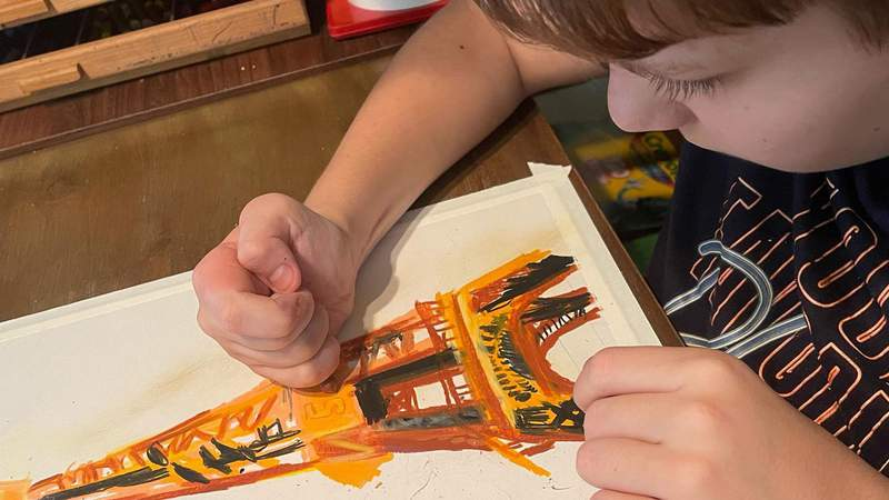 Viktor, 12, paints with oil pastels from his home in Aventura.