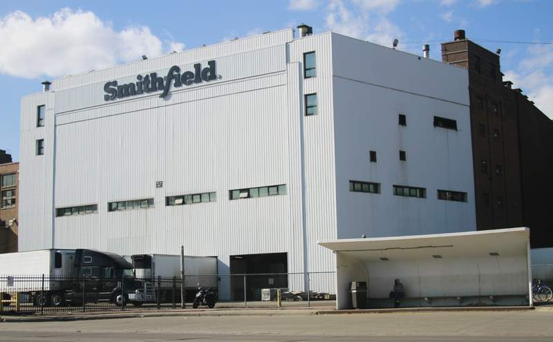 FILE - This April 8, 2020, file photo shows the Smithfield pork processing plant in Sioux Falls, S.D. The USDA said on Wednesday, May 26, 2021, it will not increase the speed at which pigs are processed into meat at U.S. pork plants rejecting a request from a group representing pork producers to allow processing plants to speed up the production of pigs into meat. A union representing workers claimed that the increased volume endangers workers. (AP Photo/Stephen Groves, File)